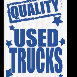 quality used trucks sign